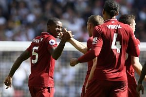 Liverpool's Georginio Wijnaldum (left) celebrates with his teammates after scoring against Tottenham during their English Premier League soccer match at Wembley Stadium, on Sept 15, 2018.
