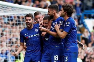 Chelsea's Eden Hazard celebrates scoring their third goal from the penalty spot with team mates.