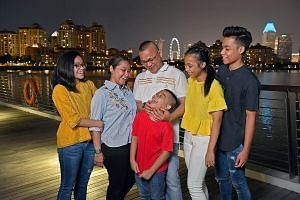 Madam Nurani Abdul Ghani and her husband Sairee Sinwan with their four children (from left) Syukrina, Nihal, Nusratina and Syabil.