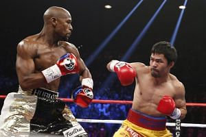 Floyd Mayweather Jr. (left) defends against Manny Pacquiao during their 2015 Las Vegas bout.