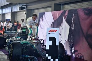 Mercedes' Lewis Hamilton celebrates after winning the 2018 Singapore Airlines Singapore Grand Prix on Sept 16, 2018.