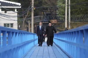 South Korean President Moon Jae-in and North Korean leader Kim Jong Un during their summit at the Panmunjom truce village, on April 27, 2018.