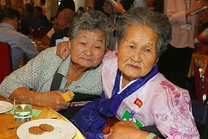 North Korean Kang Ho Rye (right), 89, hugging her South Korean sister Kang Du-ri, 87, as they bid farewell at the last meeting of a three-day family reunion event at North Korea's Mount Kumgang resort on Aug 26. Millions of Koreans were separated fro