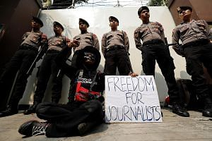 A journalist protesting against the imprisonment by Myanmar of Reuters journalists Wa Lone and Kyaw Soe Oo, outside the Myanmar Embassy in Jakarta earlier this month. The two were sentenced to seven years in prison, triggering outrage from the UN and