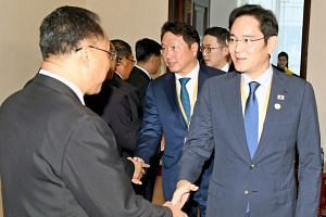 North Korea's deputy prime minister for economy Ri Yong Nam (left) greets Samsung heir Lee Jae-yong prior to their meeting at the People's Palace of Culture in Pyongyang on Sept 18, 2018.