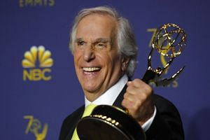 Henry Winkler poses with his best supporting actor in a comedy award for television series Barry.