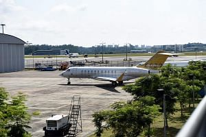 A Bombardier Global 5000 jet plane without a body number is seen parked on the tarmac of Seletar Airport, on Feb 6, 2017.
