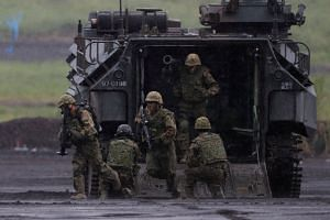 Japanese Ground Self-Defense Force members take part in an annual training session near Mount Fuji at Higashifuji training field in Gotemba, Japan, on Aug 23, 2018.