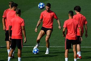 Real Madrid captain and defender Sergio Ramos (on the ball) with teammates at the Valdebebas training ground in Madrid yesterday, ahead of the holders' opening Champions League match against last season's semi-finalists Roma.