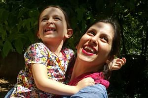 Nazanin Zaghari-Ratcliffe embracing her daughter Gabriella in Damavand, Iran following her release from prison for three days.