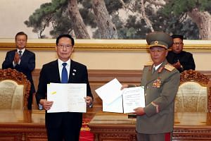 South Korean Defence Minister Song Young-moo (second from left) and his North Korean counterpart No Kwang Chol (second from right) during a signing ceremony after the inter-Korean summit at Paekhwawon State Guesthouse, on Sept 19, 2018.