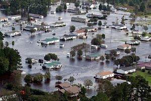 Flooded homes on the outskirts of Lumberton, North Carolina, on Monday. Hurricane Florence was downgraded to Category 1 when it ploughed ashore last Friday, but its sluggish pace resulted in record-breaking rainfall totals.
