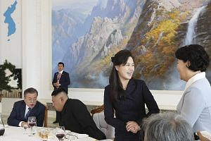 Above: North Korean leader Kim Jong Un (second from left) and his wife Ri Sol Ju (third from left) had lunch with South Korean President Moon Jae-in and First Lady Kim Jung-sook at Pyongyang's famous cold noodle restaurant Okryu-gwan yesterday. Right