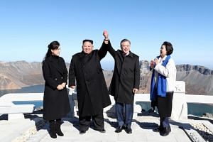 South Korean President Moon Jae-in (second from right) and his wife Kim Jung-sook (right) pose with North Korean leader Kim Jong Un (second from left) and his wife Ri Sol Ju, on the top of Mount Baekdu, North Korea, on Sept 20, 2018.