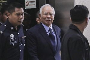 Former Malaysian prime minister Najib Razak (centre) arrives at the High Court in Kuala Lumpur, Malaysia, on Sept 20, 2018.