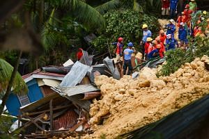Rescuers search for survivors at the landslide site in Naga City, on the popular tourist island of Cebu, on Sept 20, 2018.