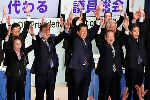 Japan's Prime Minister Shinzo Abe and his Liberal Democratic Party members cheering after he won the leadership vote yesterday. He will reshuffle his Cabinet after returning from a trip to New York for a United Nations General Assembly gathering next