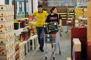 Customers buy imported items at a store in Qingdao in China's eastern Shandong province on Sept 19, 2018.