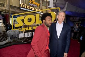Actor Donald Glover (keft) and Disney chief Bob Iger attending the premiere of Solo: A Star Wars Story in Hollywood.