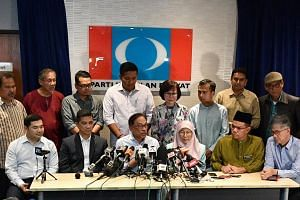 The focus will be on the post of deputy president of Malaysia's PKR after Datuk Seri Anwar Ibrahim (centre) was returned unopposed as president on Aug 5.