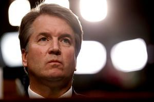 US Supreme Court nominee Judge Brett Kavanaugh listens during his confirmation hearing.