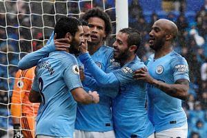 Manchester City's Riyad Mahrez celebrates scoring their fourth goal with team mates.