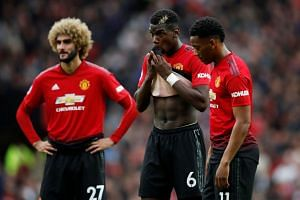 Manchester United's Marouane Fellaini, Paul Pogba and Anthony Martial.