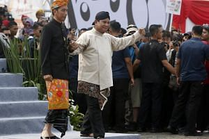 Indonesian President Joko Widodo and his challenger Prabowo Subianto at a ceremony marking the start of the campaigning period for next year's presidential election in Jakarta on Sept 23, 2018.