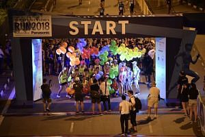 Pacers at the starting point of the 18.45km race along Nicoll Highway at around 4.30am.