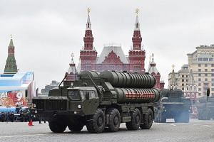File photo of Russian S-400 Triumph medium-range and long-range surface-to-air missile systems riding through Red Square during the Victory Day military parade in Moscow, on May 9, 2017.