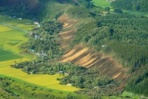 Houses damaged by a landslide in Atsuma town, Hokkaido prefecture on Sept  6, 2018. The earthquake dealt a major blow to the agriculture, forestry and fisheries industries in Hokkaido.