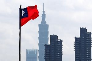 Taiwan's national flag flies in front of the Taipei 101 skyscraper in Taipei, Taiwan on March 1, 2018.