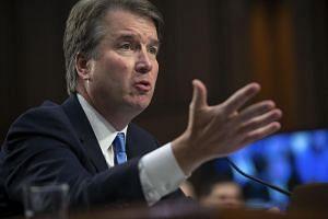 Brett Kavanaugh (pictured) faces an explosive Senate showdown against university professor Christine Blasey Ford.