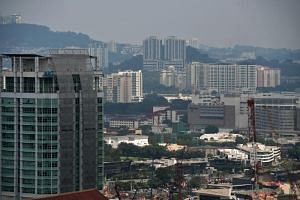 File picture of the city skyline of Kuala Lumpur. The number of unsold housing units in Malaysia rose to 146,196 units at the end of March.