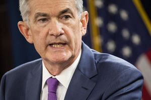 Fed chairman Jerome Powell announcing that the Fed is raising interest rates at a news conference.