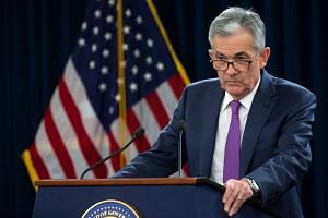 Jerome Powell holds a news conference following a two-day Fed policy meeting in Washington.