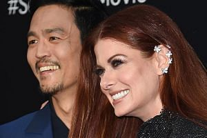 Actor John Cho and actress Debra Messing at the Hollywood premiere of Searching last month.