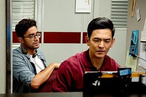 Director Aneesh Chaganty on the set of Searching with actor John Cho.