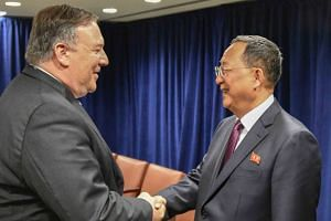 "Pompeo tweeted with photos (above) that he had a ""very positive meeting"" with Foreign Minister Ri Yong Ho."