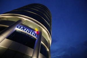 A source said Axiata is also in talks to team up with private equity firms and other companies as it considers options to launch its own offer for a bigger stake in M1.