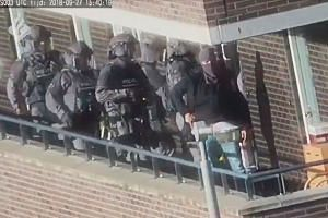 A video grab shows Dutch police special forces raiding a house in Arnhem, Netherlands, on Sept 27, 2018.