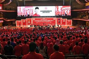 Umno members at the five-day general assembly the party held last year when it was still in power. Its general assembly this year, which starts today, is a three-day affair. With its 49 seats, Umno is no longer the biggest party in Malaysia's Parliam
