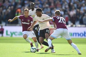 Manchester United's Anthony Martial (centre) in action during the match.