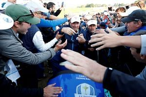 Team Europe captain Thomas Bjorn with fans during the Foursomes.