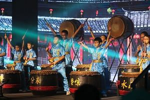 The Qifa Chinese Drum Troupe performing at the Char Yong (Dabu) Association's 160th anniversary gala dinner at Marina Bay Sands yesterday. Prime Minister Lee Hsien Loong cited the association as one that has worked hard to attract and groom its young