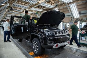 A vehicle factory line in China. The writer says that if Beijing sees no prospect of a settlement of the trade war with Washington that lets both sides walk away at an acceptable cost, it will dig in and take whatever pain the US can inflict, knowing