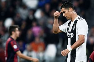 Ronaldo reacts during an Italian Serie A football match between Juventus and Bologna.