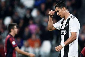 Ronaldo reacts during an Italian Serie A football match between Juventus and Bologna.