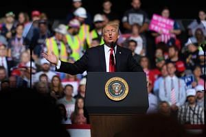 US President Donald Trump speaks to supporters at his rally inside the WesBanco Arena, in Wheeling, West Virginia, on Sept 29, 2018.