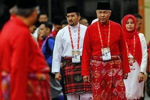 Umno party's (from left) Youth Chief Asyraf Wajdi Dusuki, president Ahmad Zahid Hamidi and Women Wing's Noraini Ahmad walk during the opening ceremony of Malaysia's ruling party Umno General Assembly 2018 in Kuala Lumpur, on Sept 29, 2018.